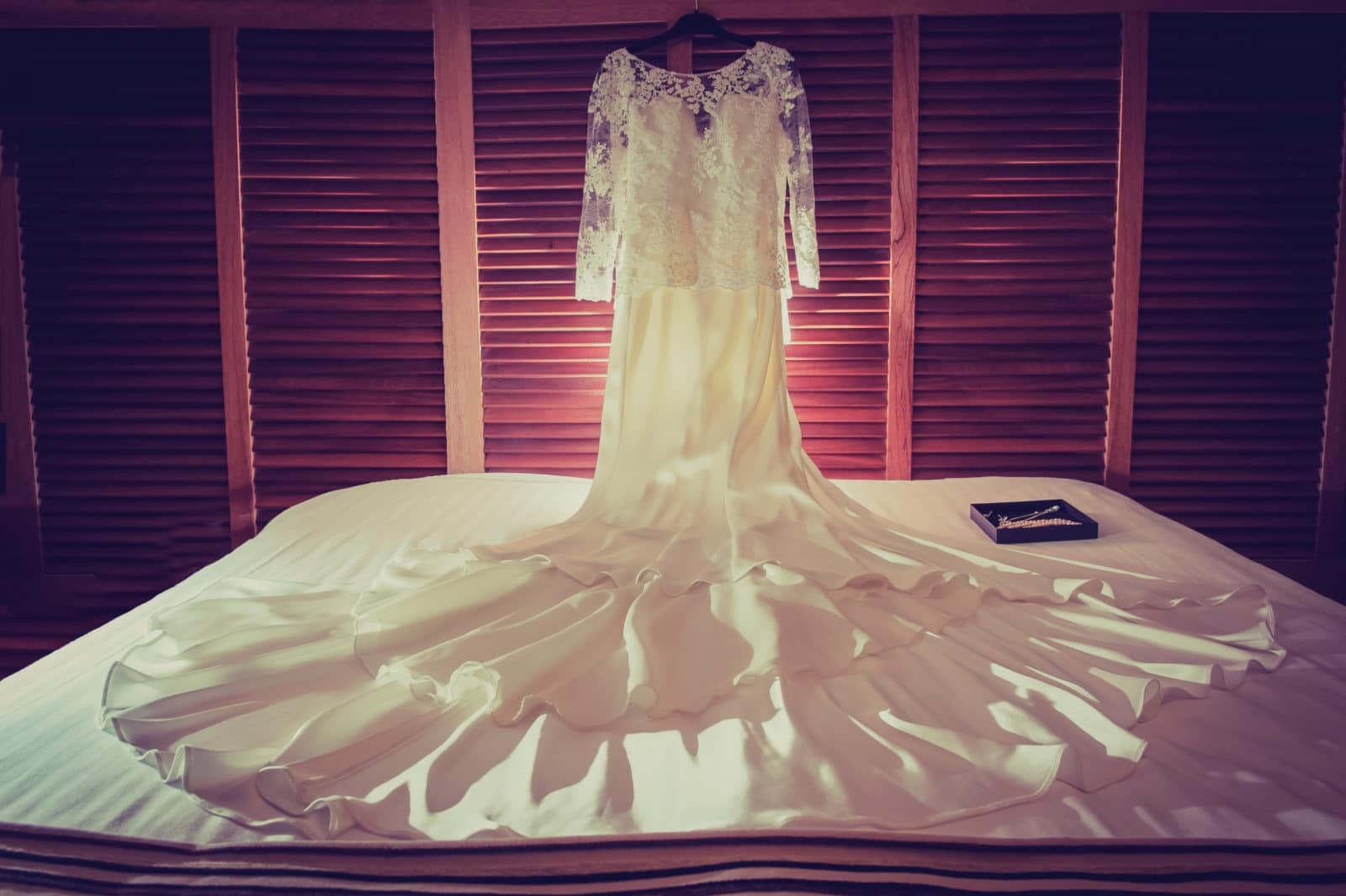 a-wedding-dress-on-a-bed