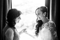 a-bride-and-her-mother-in-front-of-a-window